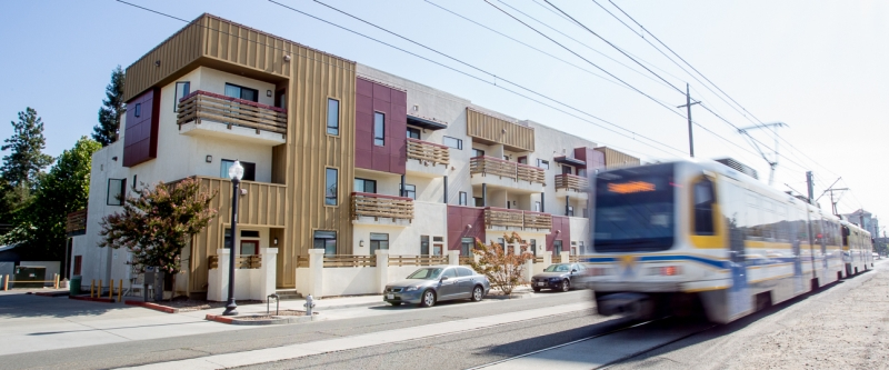 Light Rail zooms by housing complex