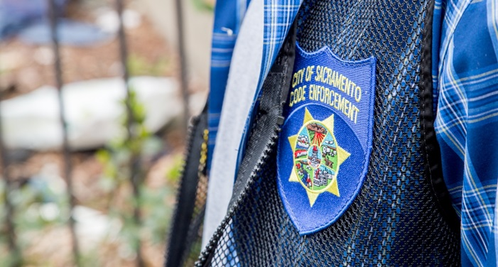City of Sacramento Code Enforcement Badge on vest