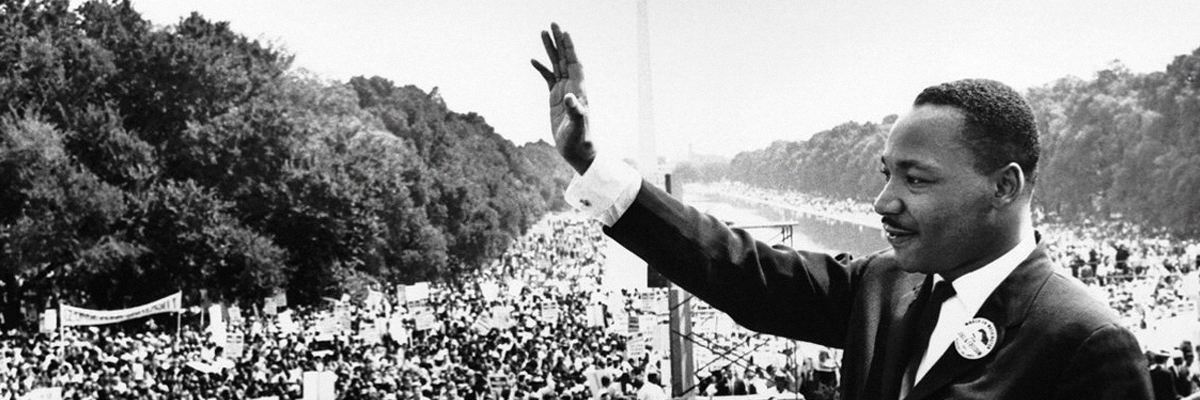 Dr. Martin Luther King, Jr. waves during the march on Washington.