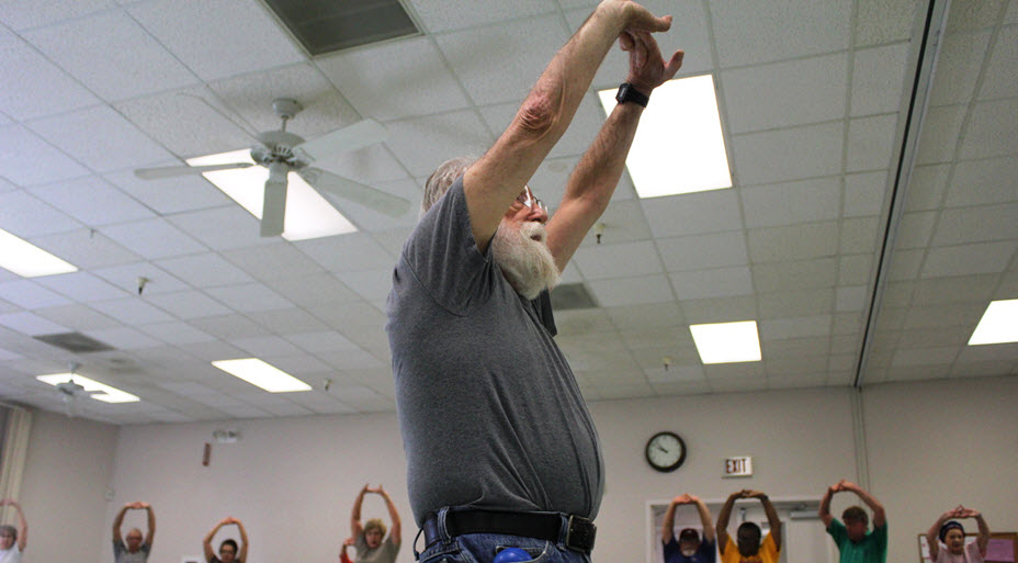 Older man leads fitness class