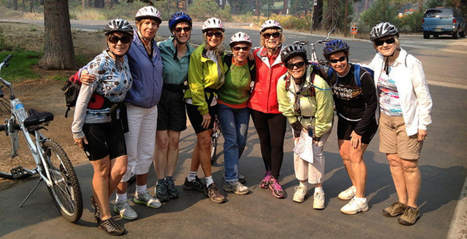 Older adult biking group smiling at camera