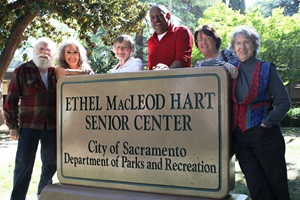 Older adults smiling by Hart sign