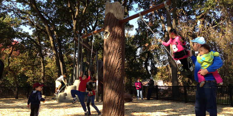 Family using swings at Bannon Creek Park Playgound Opening - opened November 2015