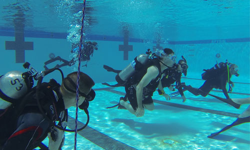 Participants learning how to scuba dive