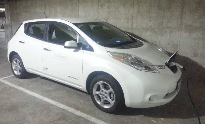 Electric vehicle plugged in and charging