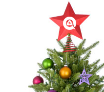 christmas tree with recycle logo on star topper
