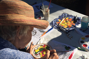 Senior painting at Senior Summer Camp