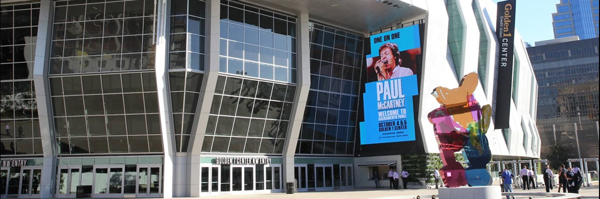 G1C Exterior Shot featuring Paul McCartney banner and Dean Koons sculpture.