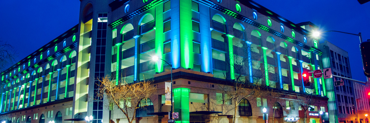 Evening photo of Sacramento City Hall Garage with blue and green lights