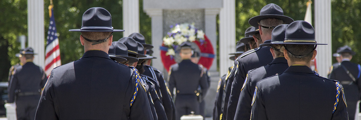 Officers at the Woodlake Park Police Memorial