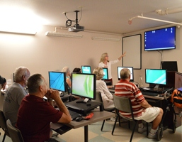 Older adults take a computer class at the Hart Senior Center
