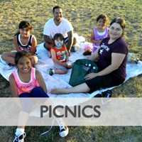 City of Sacramento family relaxing on blanket at a park.