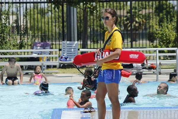 Lifeguard and swimmers at City pool