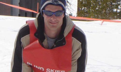 Camp participant who is also a blind skier
