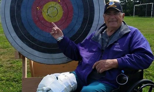 Participant proudly displaying his archery target hits.