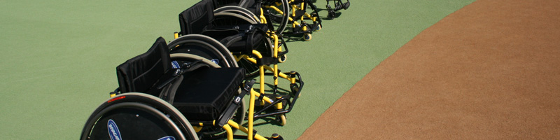 Sports Wheelchairs on River Cats Independence Field rubberized field.