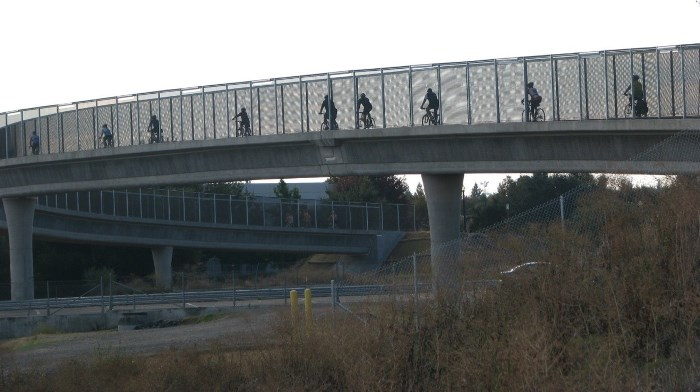 Bicyclists crossing Interstate 80 on the new bridge