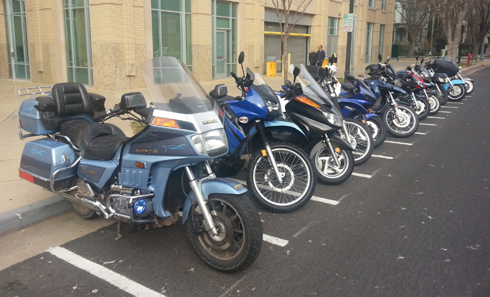 Line of motorcycles parked in front of City Hall