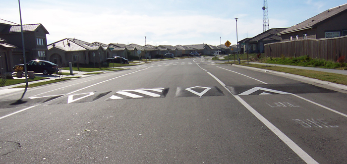 Speed lumps on a residential street to slow traffic